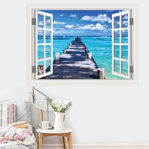 Janela Pontão na praia, autocolante de parede decorativo. Autocolante que simula o efeito de uma janela