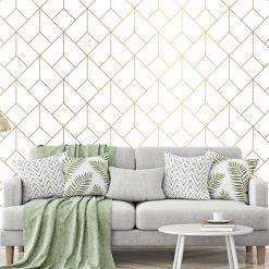 Papel de parede Geométrico ouro padrão em vinil autocolante decorativo. Aplique esta imagem em qualquer superfície lisa e sem textura. Além disso, ao contrário do papel de parede tradicional, não precisa aplicar colas.
